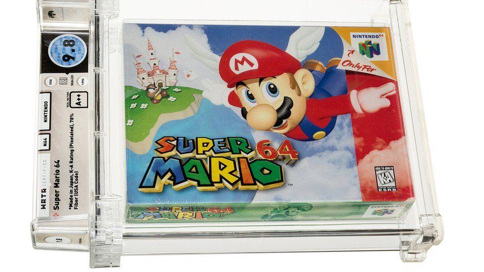 電子遊戲《超級馬里奧 64》的密封副本在拍賣會上以超過 150 萬美元(110 萬英鎊)的價格售出,打破了記錄。